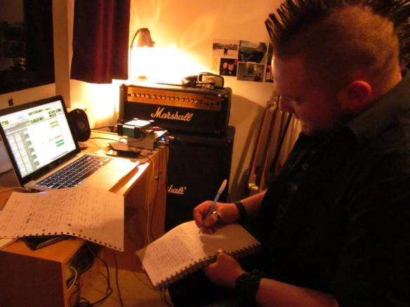 Keith writing lyrics in my bedroom studio during a late night recording session